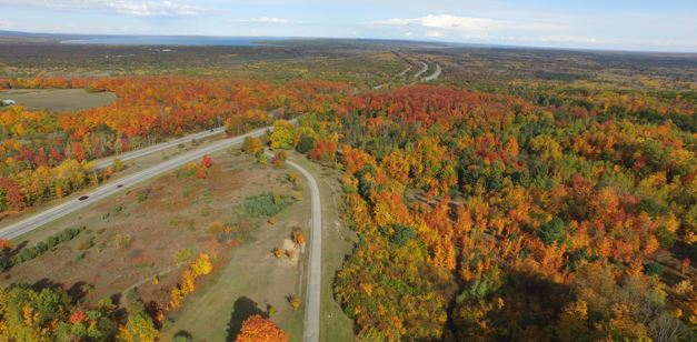 Aerial shot of I-75and roads leading to Indian River, fall colors at peak with Burt Lake in the Top