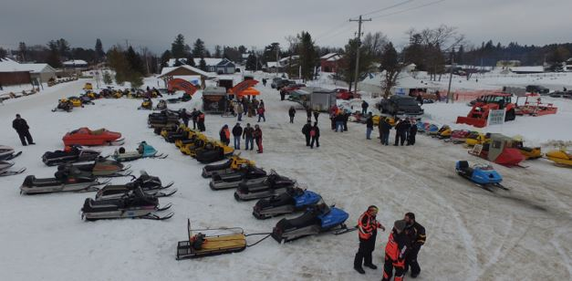 Snowmobiles lined up on Trail