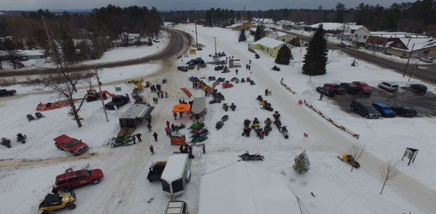Aerial Shot of Vintage Snowmobiles on Trail